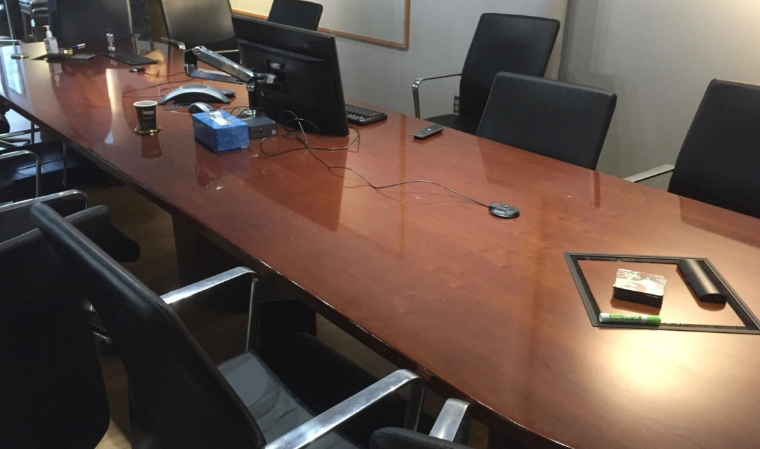 Conference-table-in-need-of-refinishing