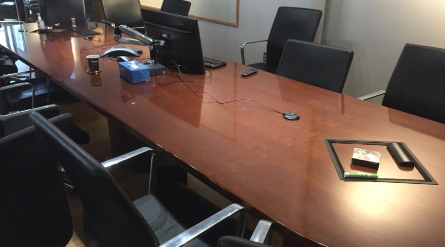 Conference table in need of refinishing